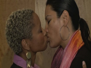 Ebony lesbian tongue kissing